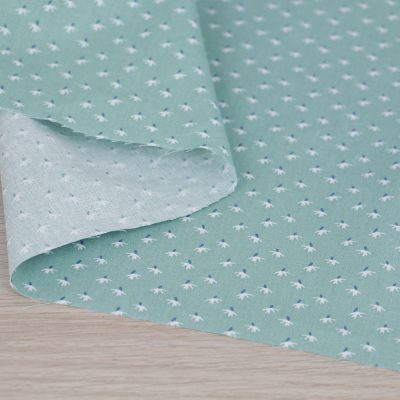Tessuto in cotone con soffioni su fondo azzurro