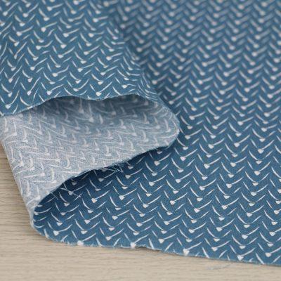 Tessuto in cotone geometria con fondo petrolio