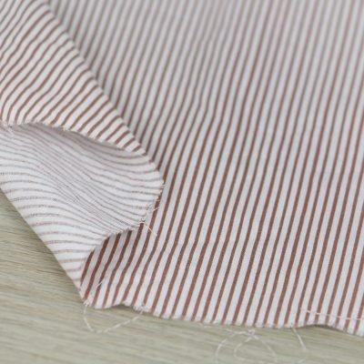 Tessuto in cotone a righe bianche e rosse