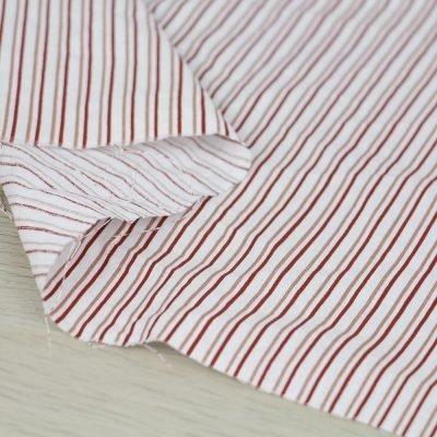 Tessuto in cotone a righe verticali rosse e rosa