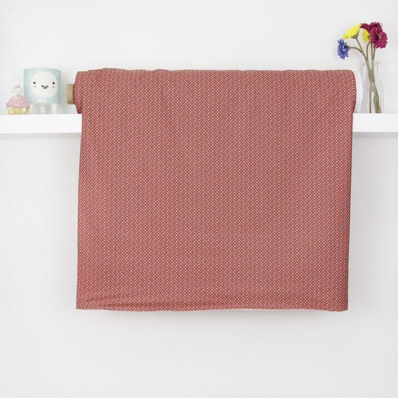 Tessuto in cotone geometria con fondo rosso