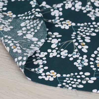Tessuto in viscosa con stampa a fiorellini e fondo verde scuro