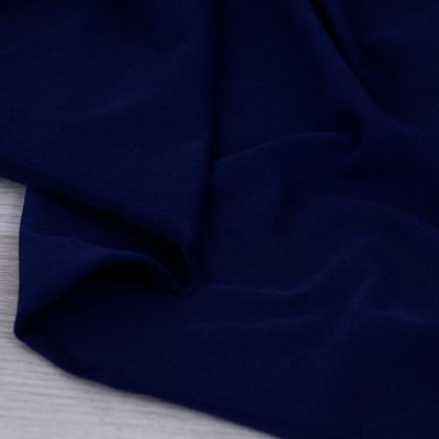 Tessuto in jersey di cotone tinta unita blu navy