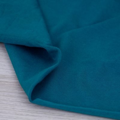 Tessuto in jersey di cotone tinta unita petrolio