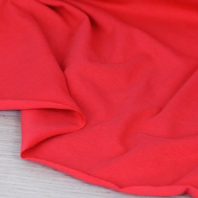 Tessuto in jersey di cotone tinta unita rosso