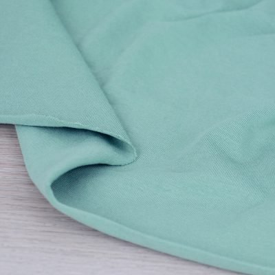 Tessuto in jersey di cotone tinta unita verde salvia