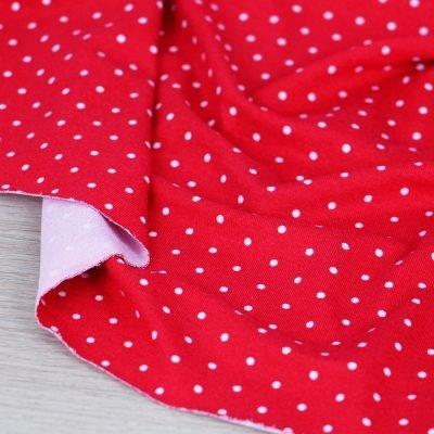 Tessuto in jersey di viscosa rosso con mini pois