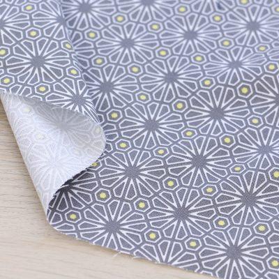 Tessuto in cotone Gütermann Natural Beauty geometria grigio e giallo