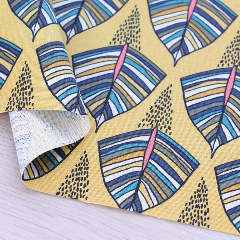 Canvas di cotone con stampa a fondo giallo