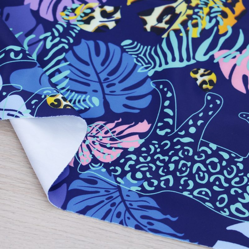 Lycra per costumi da bagno con stampa tropicale blu