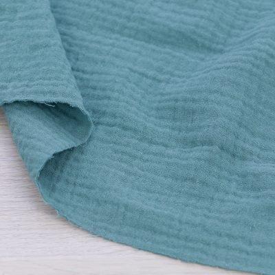Tessuto mussola di cotone verde eucalipto
